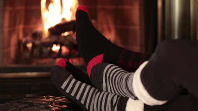 feet warming by fireplace - toe stock videos & royalty-free footage