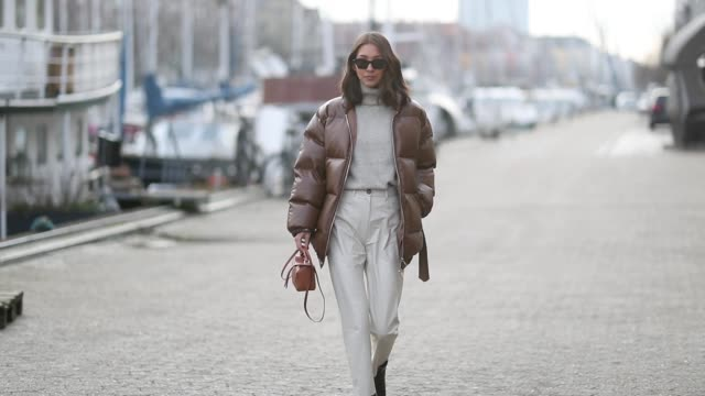 stockvideo's en b-roll-footage met felicia akerstrom ma is seen wearing brown puffer jacket mini loewe bag grey turtleneck cropped pants outside nanushka lunch during the copenhagen... - week