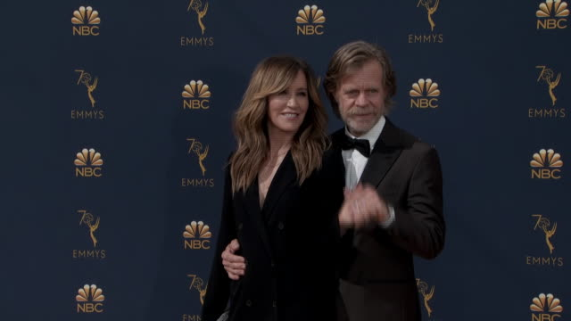 felicity huffman and william h. macy pose on the red carpet at the 2018 primetime emmy awards at the microsoft theater in los angeles, california. - microsoft theater los angeles stock videos & royalty-free footage