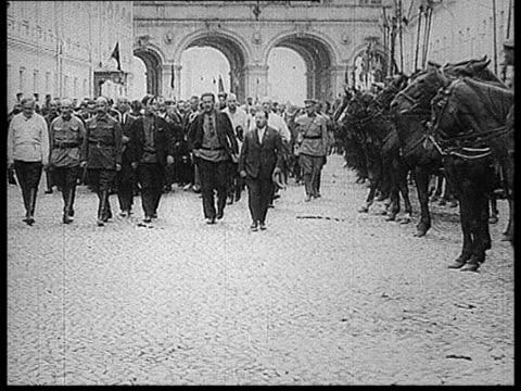 Felix Edmundovich Dzerzhinsky's burial Dzerzhinsky's coffin being carried from lateral gate of Kremlin Wall Stalin among people following coffin...