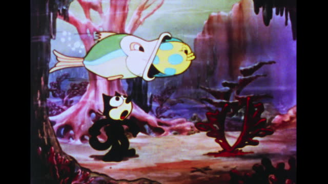 felix the cat tries to capture goldfish but bigger and bigger fish come and eat each other - small stock videos and b-roll footage