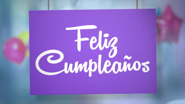 Feliz cumpleaños sign hanging from ropes. Luma matte included so you can put your own background.
