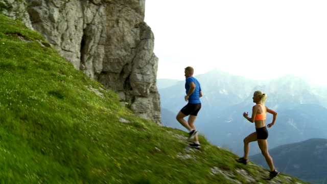 HD: Fell Runners Running Along Mountain Ridge