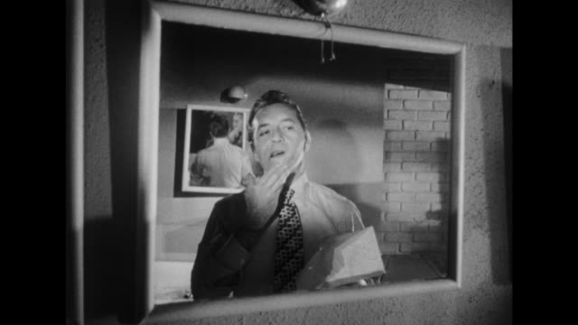 stockvideo's en b-roll-footage met 1948 fellow employee in restroom asks a calm fired man on his future career moves - ontslaan