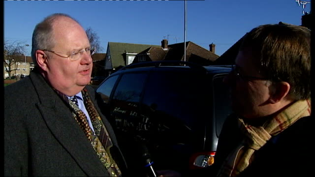 vidéos et rushes de eric pickles mp towards mark bowen chatting to woman and along wide shot of plane flying over houses eric pickles mp interview with reporter in shot... - eric