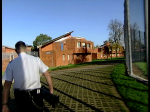 Feltham Young Offenders Institute criticised GVs EXT Prison officer along through garden / prison officer into education block / prison officer along...