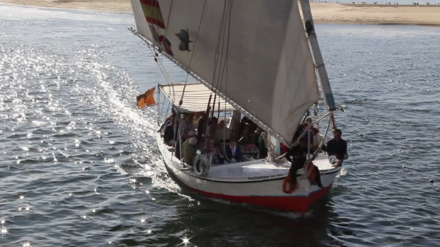 MS PAN Felucca filled with tourists moving in lake / Aswan, Egypt