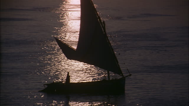 a felucca sails on the nile river in egypt. - river nile stock videos & royalty-free footage