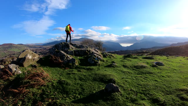 female adventure hiker with rucksack trekking outdoor snowdonia - film moving image stock videos & royalty-free footage
