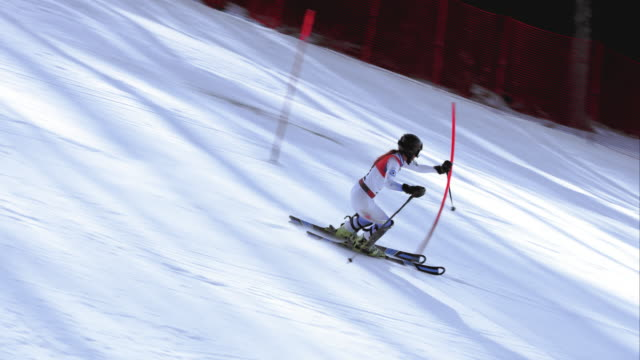 ts female alpine skier passing the gates in a slalom race - the competition stock videos and b-roll footage