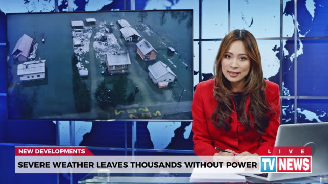 LD Female anchor presenting breaking news about severe weather causing power outage
