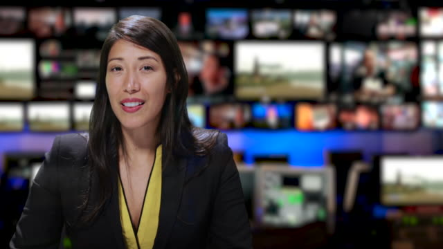 ms female anchor speaking at news desk - news event stock videos & royalty-free footage