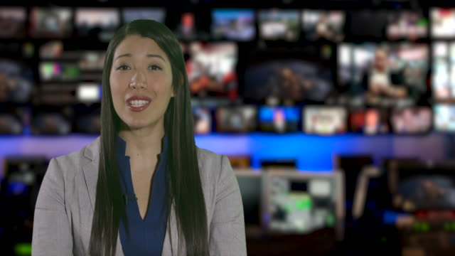ms female anchor speaking at news desk - journalist stock videos & royalty-free footage