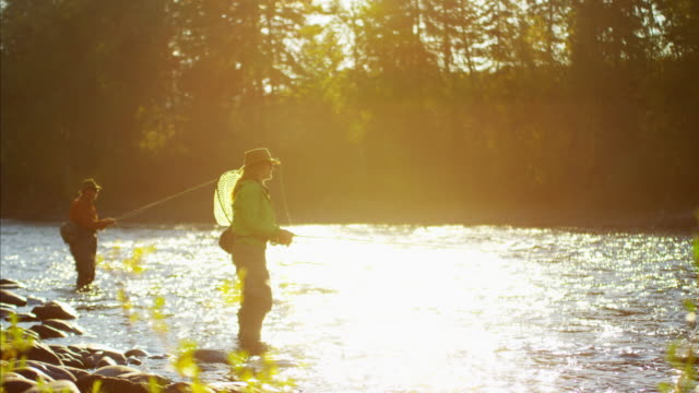Female and male casting line freshwater fishing USA