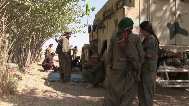 female and male kurdish fighters of the people's defense forces hpg the military wing of the kurdistan workers' party pkk chat before going into... - kurdistan workers party stock videos & royalty-free footage