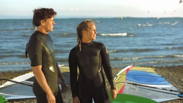 stockvideo's en b-roll-footage met female and male windsurfer portrait - windsurfen
