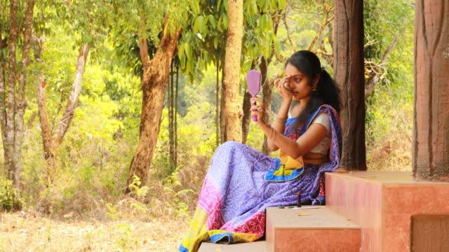 female applying bindi - bindi stock videos and b-roll footage