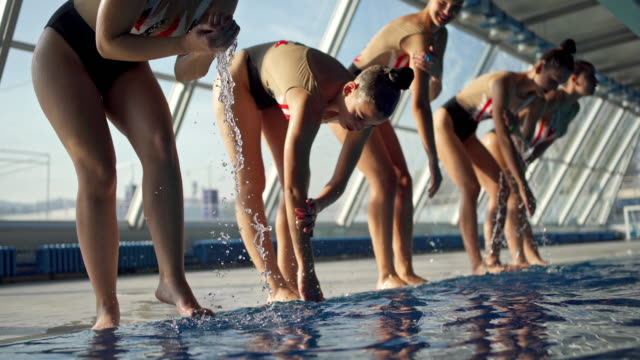 female aquatic sports team warming up together - water sport stock videos & royalty-free footage