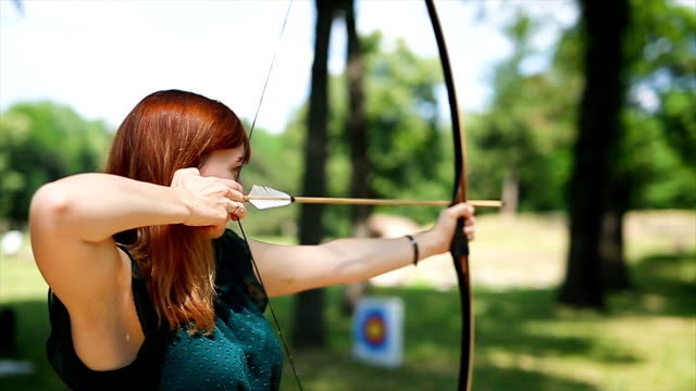female archer in the fieald - bow and arrow stock videos and b-roll footage