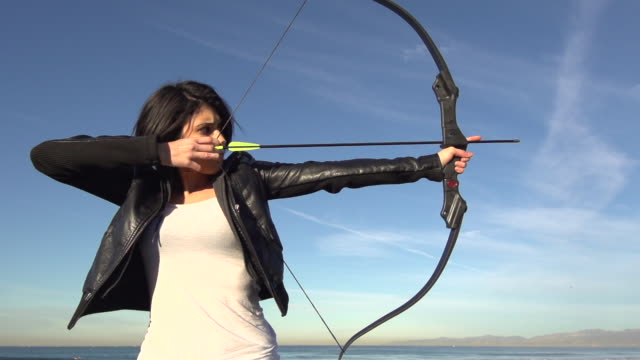 a female archer shooting targets with her bow and arrow.  - super slow motion - filmed at 240 fps - bow and arrow stock videos and b-roll footage