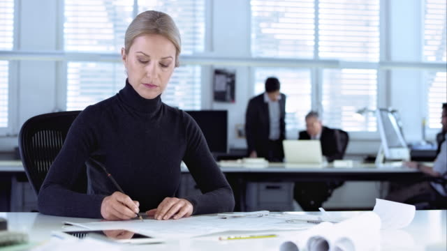 ds female architect drawing the design on paper in office - turtleneck stock videos & royalty-free footage