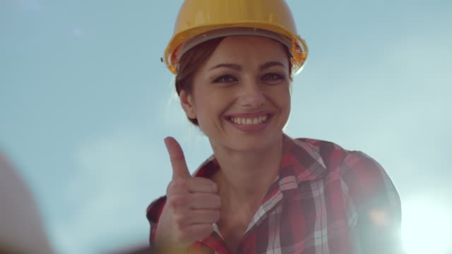 Female architect showing thumbs up