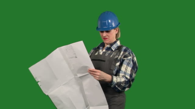 ms female architect watching blueprint and directing / meribor, slovenia  - tape measure stock videos & royalty-free footage