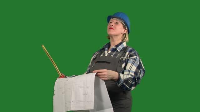 MS Female architect watching blueprint and directing / Meribor, Slovenia