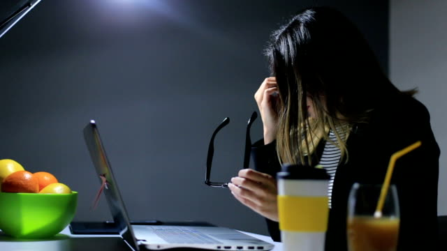 Female Architect Working Late In Her Office