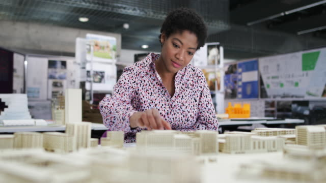 female architect working on model - architect stock videos & royalty-free footage