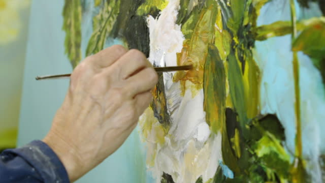 female artist producing oil painting of flowers on canvas - oil paint stock videos and b-roll footage