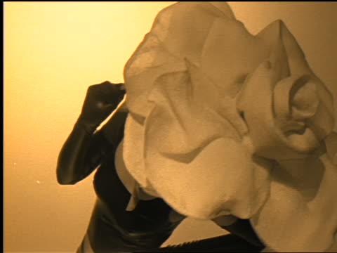 sepia female asian model posing with large flower hat in studio - hat stock videos & royalty-free footage