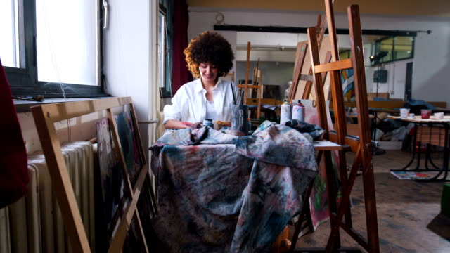 female at her art studio painting - art studio stock videos & royalty-free footage