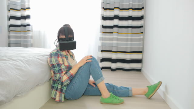 female at home wearing virtual reality gear. - illusion stock videos & royalty-free footage