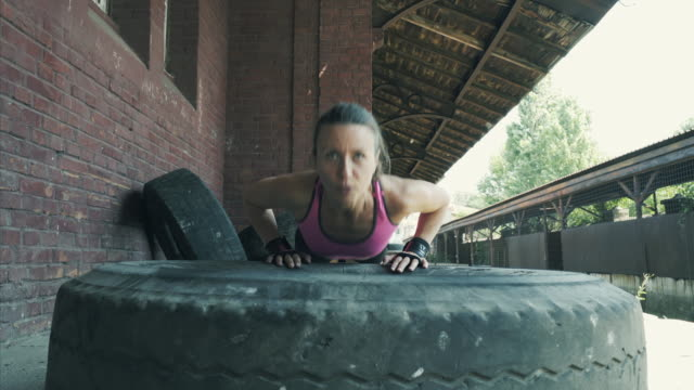 female athlete doing push ups. - concentration stock videos & royalty-free footage