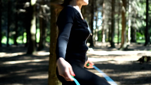 female athlete doing workout with jump rope - jump rope stock videos & royalty-free footage