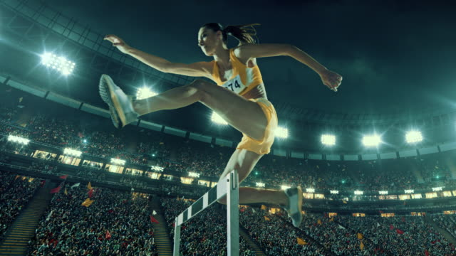 female athlete hurdle on sports race - hurdle stock videos & royalty-free footage