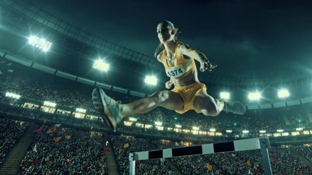 vídeos de stock e filmes b-roll de female athlete hurdle on sports race - esforço