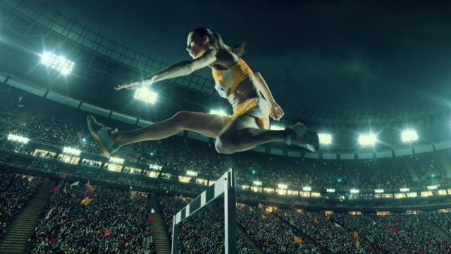 female athlete hurdle on sports race - atletico video stock e b–roll