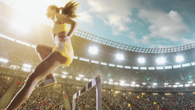 female athlete hurdle on sports race - sports track stock videos & royalty-free footage