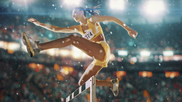 female athlete hurdle on sports race - flexibility stock videos & royalty-free footage