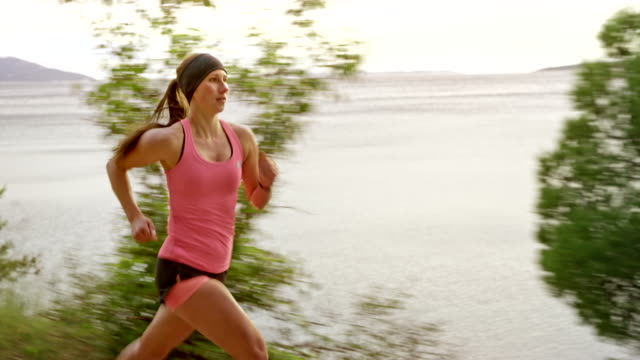 ts female athlete running by the sea - vest stock videos and b-roll footage