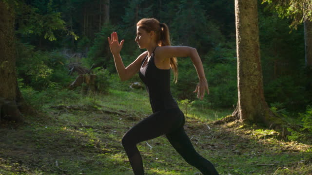 female athlete running in the woods - flexibility stock videos & royalty-free footage