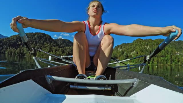 pov female athlete sculling in a double scull on a sunny day - sculling stock videos and b-roll footage