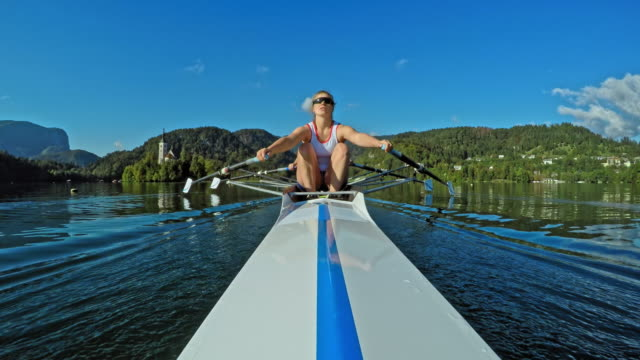 pov female athlete sculling with team mate in a double scull - sculling stock videos & royalty-free footage
