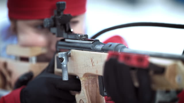 slo mo female athlete shooting the biathlon rifle - biathlon stock videos and b-roll footage