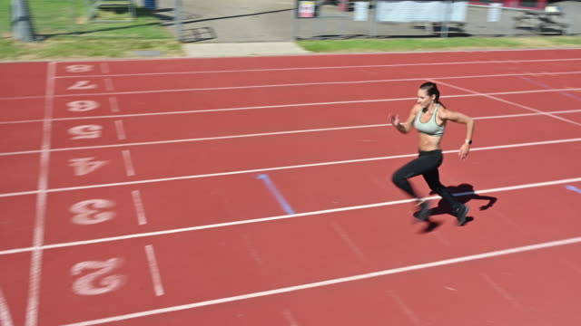 female athlete sprinting to finish line on sports track - less than 10 seconds stock videos & royalty-free footage
