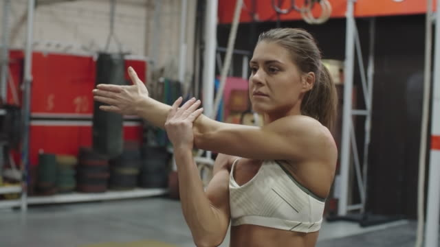 Female athlete stretching arms and shoulders