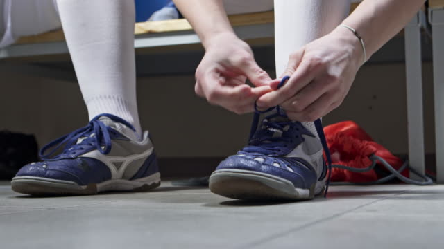 cu female athlete tying shoelaces - shoelace stock videos and b-roll footage