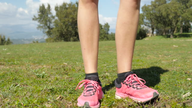 female athlete with smooth legs running outdoors - running shorts stock videos & royalty-free footage